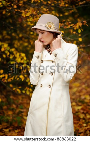 young attractive woman walking in evening autumn park