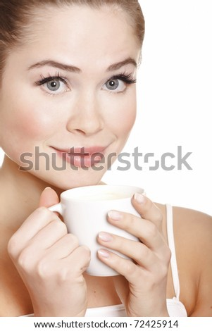 young attractive woman with cup on white background