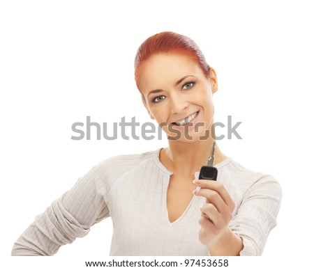 Young attractive woman with the key