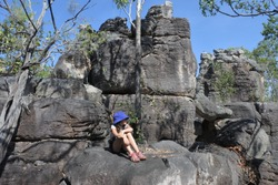 Young Australian girl (female age 8-9) visit in the lost city at Litchfield National Park near Darwin in the Northern Territory Australia. Real people. Copy space