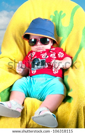 Young baby boy dressed in tourist
