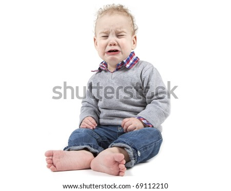Young baby boy is crying on a white background.