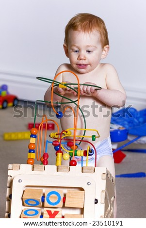 Young baby playing with a children's puzzle toy