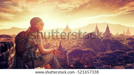 Young backpacker enjoying a looking at sunset on Bagan, Myanmar Asia. Traveling along Asia, active lifestyle concept