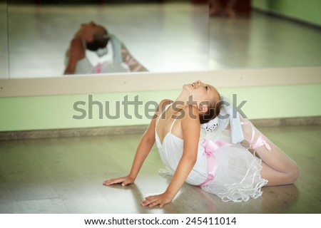 Young ballerina in tutu showing her techniques
