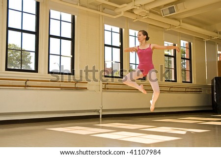 Young ballerina practicing in a dance studio.