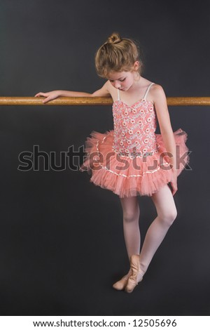 Young ballet dancer wearing an apricot tutu