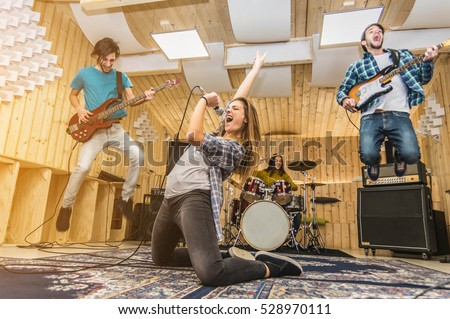 Young band music playing a song in a recording studio #528970111