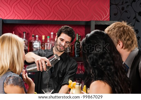 Young barman prepare drink friends at cocktail bar