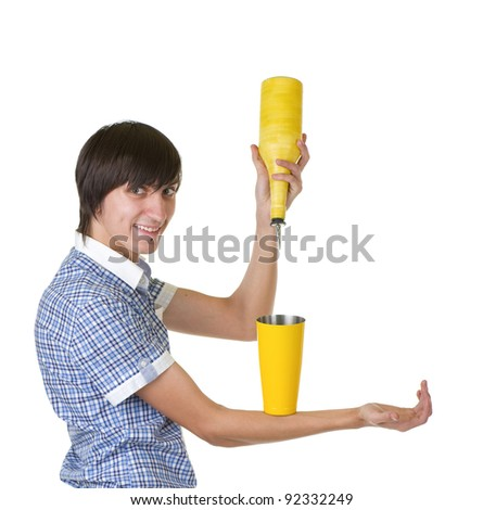 Young bartender does a trick with a shaker on white background