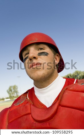 Young baseball player wearing jersey ready for a match