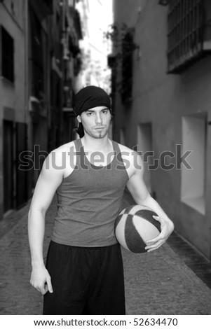 young basketball basket ball street player in old city town