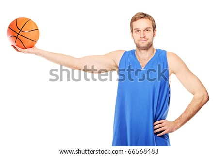 Young basketball player holding a basketball isolated on white background