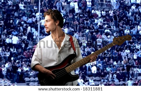 young bass guitar  player in concert
