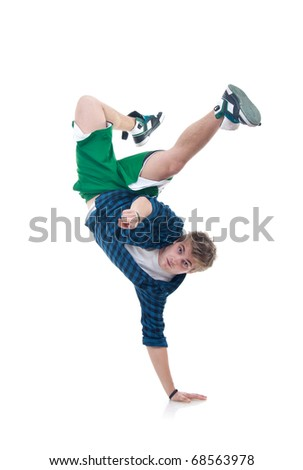 Young bboy standing on one hand. Holding legs in air. Looking and pointing at camera. Isolated on white in studio. Front view, whole body
