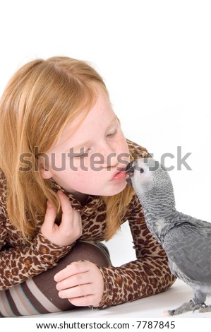 young beatifull girl kiss a baby parrot - stock photo