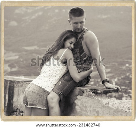 Young beauitiful couple in love summer time nature black and white vintage card