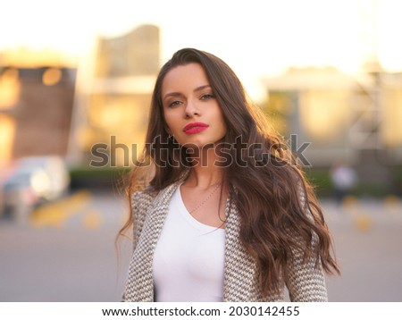 Young beautful caucasian woman with long wavy brunette hair and perfect make-up close-up outdoor portrait at sunset with backlight Photo stock ©