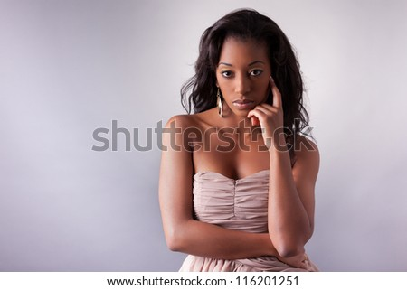 Young beautiful African american woman posing - stock photo