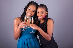 Young beautiful African American womans holding a glass of champagne