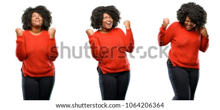 Young beautiful african plus size model happy and excited expressing winning gesture. Successful and celebrating victory, triumphant isolated over white background. Collection composition