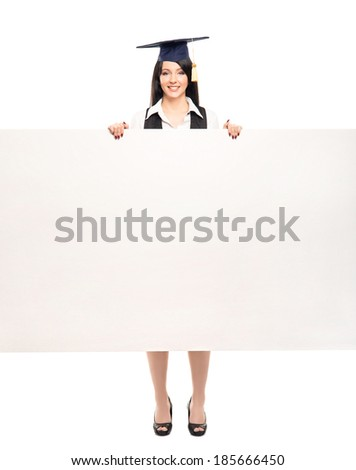 Young, beautiful and happy graduate girl with a blank banner isolated on white
