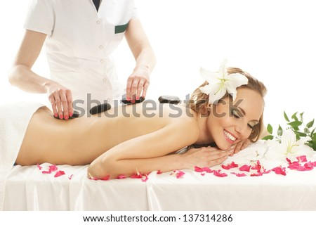 Young, beautiful and healthy woman getting spa treatment over white background - stock photo
