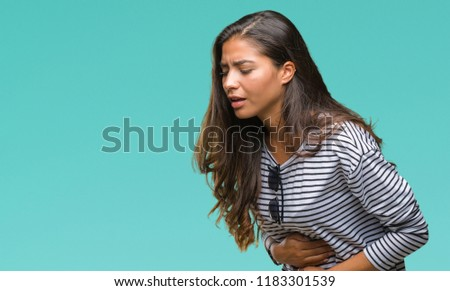 Young beautiful arab woman wearing sunglasses over isolated background with hand on stomach because indigestion, painful illness feeling unwell. Ache concept.