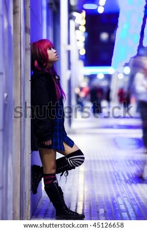 Stock Photo Young beautiful asian girl in nocturne urban scene.