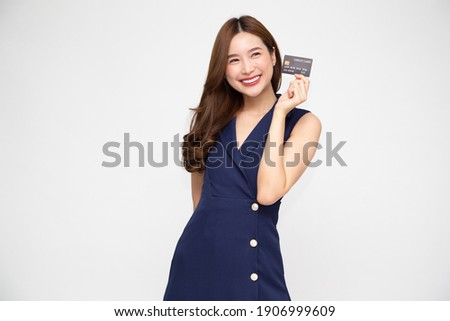 Young beautiful Asian woman smiling, showing, presenting credit card for making payment or paying online business, Pay a merchant or as a cash advance for goods, Cardholder or A person who owns a card
