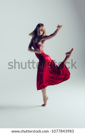 886202f59 More Images. Dancing lady in a red dress. Contemporary modern dance on a white  background isolated. Beautiful Woman Fashion Model in Red Dress ...