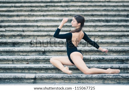 Young beautiful ballerina posing on the Spanish Steps in Rome, Italy. Ballerina Project.