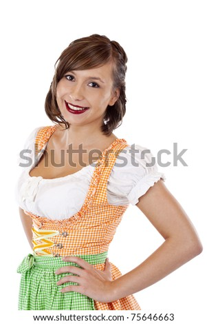 Young, beautiful, Bavarian woman in Dirndl smiles happy. Isolated on white background.