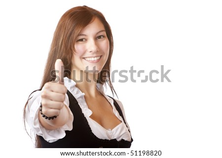 Young beautiful Bavarian woman with Dirndl dress shows thumb up. Isolated on white background.
