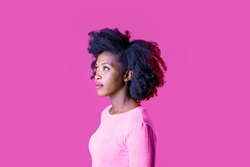 Young beautiful black woman on profile staring serene looking up serious isolated on pink background