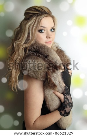 young beautiful blond in the fur cover