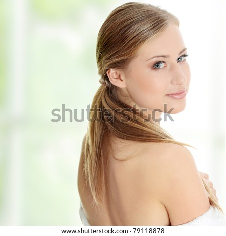 Young beautiful blond teen woman in bathrobe ready for spa