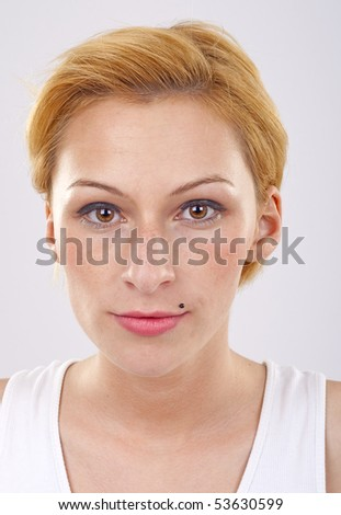 Young beautiful blond woman staring at camera