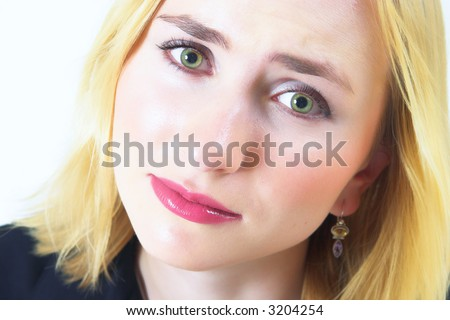 Young beautiful blond woman with sad big green eyes and pale face