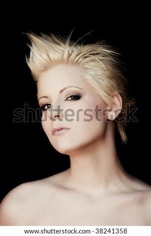 Young beautiful blonde isolated on black