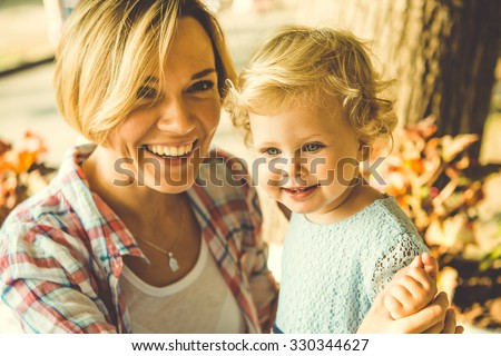 young beautiful blonde mother...