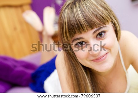 Young beautiful blonde smiling at viewer - stock photo