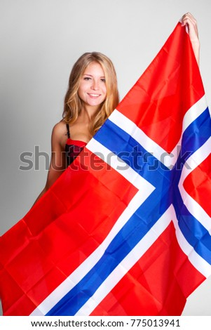 Young beautiful blonde woman holding a large transparent flag of Norway, isolated on white background