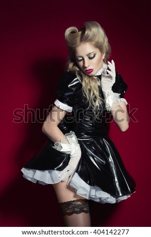 acbfbcdd0622 Young beautiful blonde woman in shiny wet look black and white pvc fetish  doll french maid