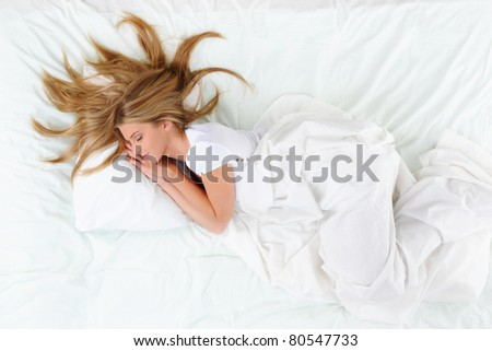 young beautiful blonde woman on the bed