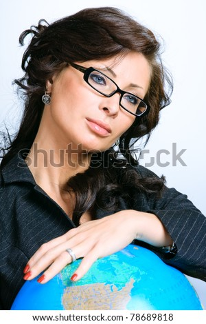 Young beautiful brunette businesswoman holding the globe