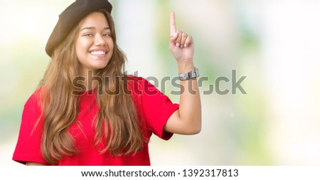048874c40c4ded Young beautiful brunette fashion woman wearing red t-shirt and black beret  over isolated background