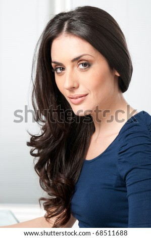 Young beautiful brunette lady smiling and looking at camera