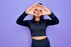 Young beautiful brunette sporty woman wearing casual sportswear over purple background doing frame using hands palms and fingers, camera perspective