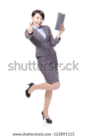 Young beautiful business woman happy using tablet pc and show thumb up in full length isolated on white background, model is asian beauty